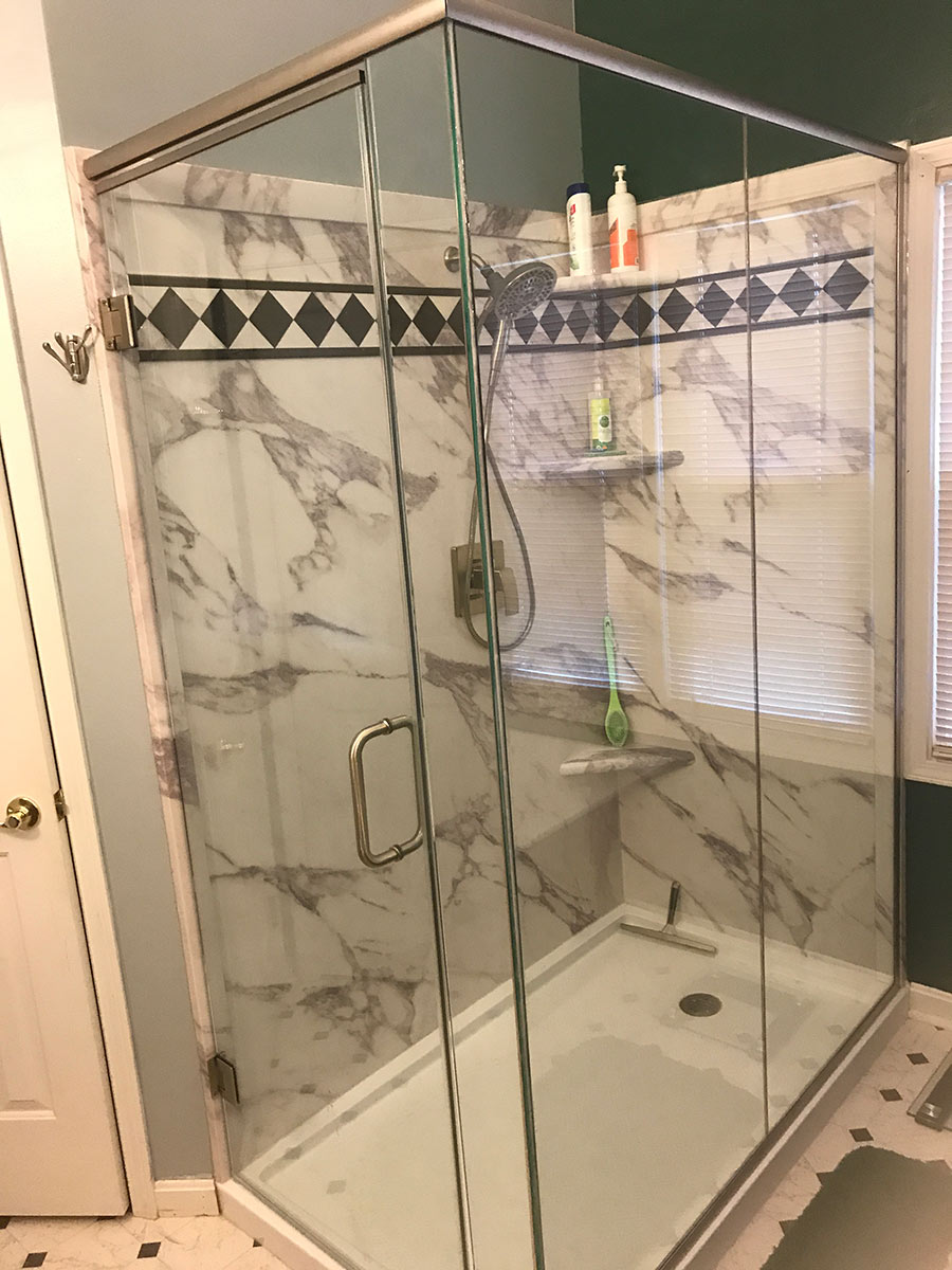Custom size corner shower with PVC composite white marble wall panels | Innovate Building Solutions | #customshower #pvcShower #Bathroomshower