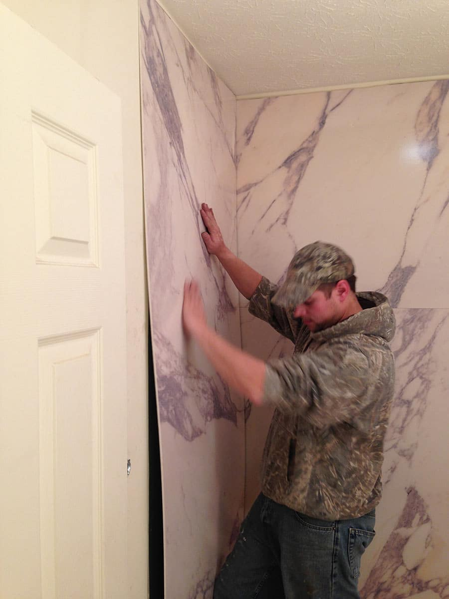 Installing PVC composite shower wall panels with a marble pattern | Innovate Building Solutions | #PVCWalls #ShowerWallPanels #Installation