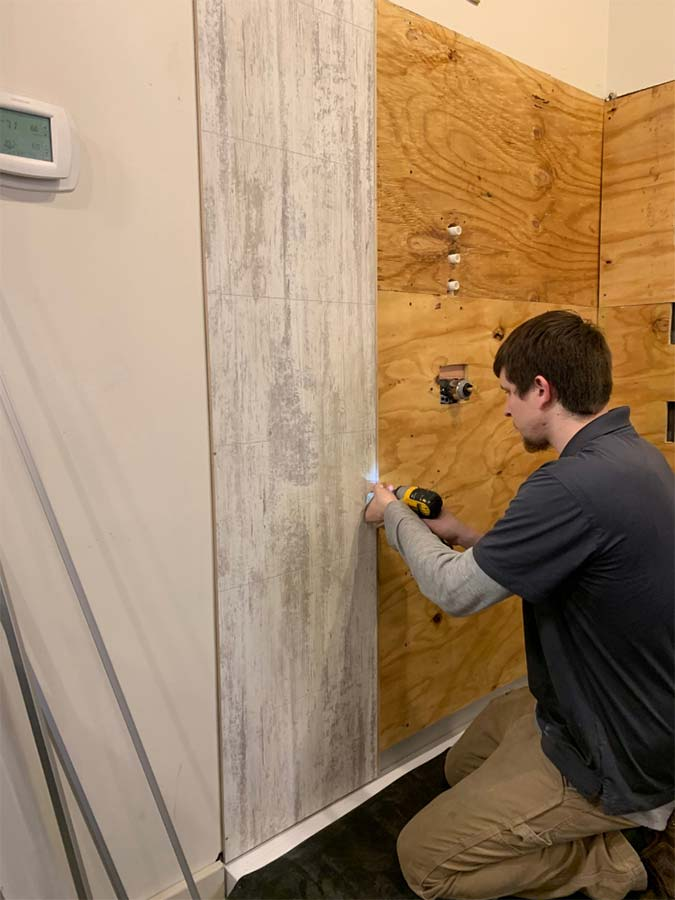 Abbey shale laminate shower wall panels being installed